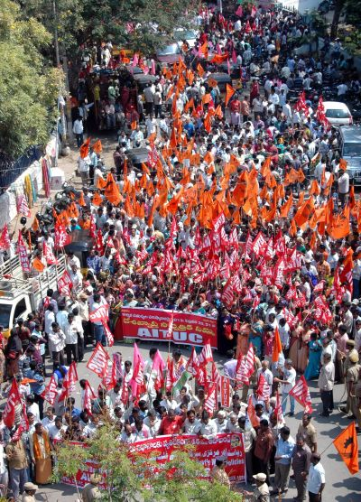 Trade union workers marching in a rally during the two-day strike in Hyderabad