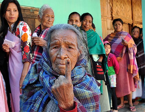 A senior citizen casts shows her inked finger after she cast her vote in Meghalaya