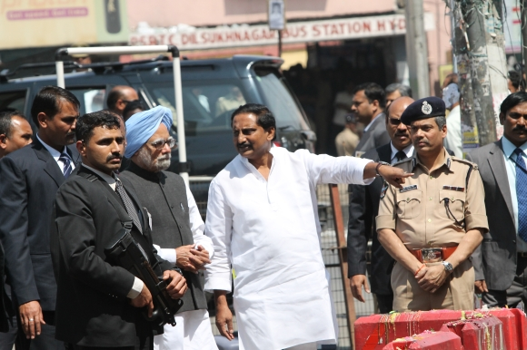 Prime Minister Manmohan Singh with Chief Minister Kiran Kumar Reddy at the blast site