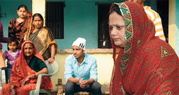 Husband of Mukhiya Poonam Devi (extreme right) was killed in 2011