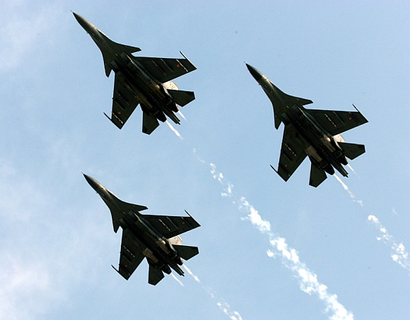 Three SU 30 MKI carrying out THE fly past at Indian Air Force Fire Power demonstration Exercise 'Iron Fist 2013' at Pokhran Firing Range, Jaisalmer, Rajasthan