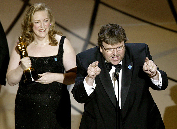 Film director Michael Moore makes an anti-war statement after he accepts his award on  March 23, 2003