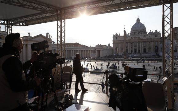 A technician works on a structure set up for TV media in front of St. Peter's Square in Rome. Pope Benedict will keep the honorific title of 'His Holiness' after he abdicates this week and will be known as 'pope emeritus', the Vatican said.