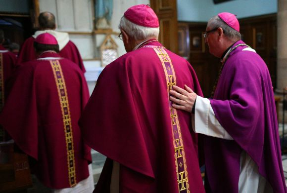 Archbishop Philip Tartaglia leaves with other priest after he conducted his first service as administrator of the Archdiocese of Edinburgh and St Andrews at St Mary's Cathedral in Edinburgh, Scotland