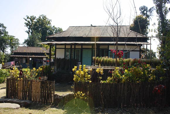 A home in the village, most homes have a garden.