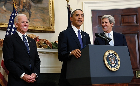 President Barack Obama announces his nomination of US Senator John Kerry, (right), to succeed Hillary Clinton as Secretary of State, while Vice President Joe Biden looks on