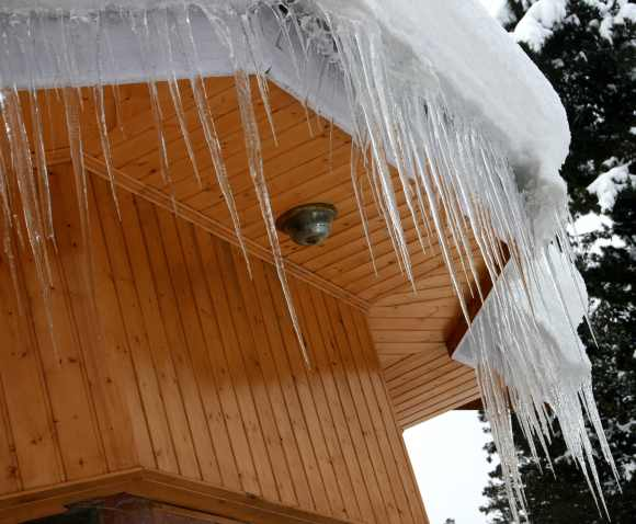 Icicles are formed on a rooftop of hut in Gulmarg