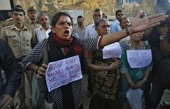 A protestor in Mumbai shouts at police officers during an anti-Delhi gangrape demonstration