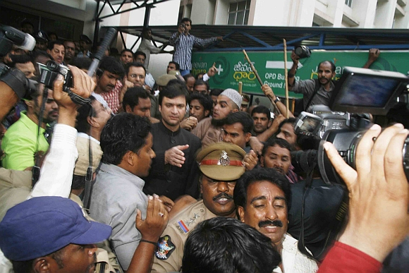 Majlis-e-Ittehadul Muslimeen MLA Akbaruddin Owaisi being taken into custody as his supporters raise slogans