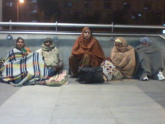 A group of people waiting outside AIIMS hospital, near the metro station