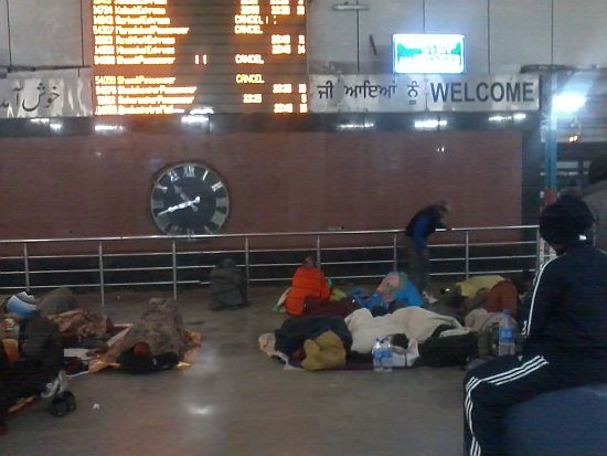People sleeping on the floor at the Old Delhi railway station