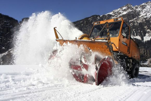A snow clearing machine at work in Gulaba village, near Manali, in Himachal Pradesh