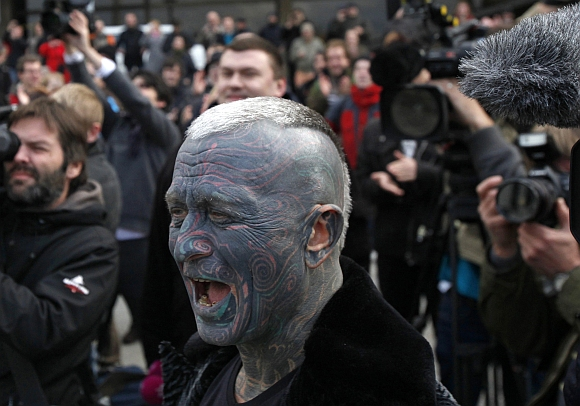 Vladimir Franz, university teacher, painter and composer who has tattoos covering 90 percent of his body arrives to a rally in Prague, after he collected more then 5,0000 supporting signatures which put him into the official race for the Czech Presidency