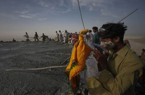 A Pakistani Hindu devotee prays at the crater of the Chandargup mud volcano in Balochistan province