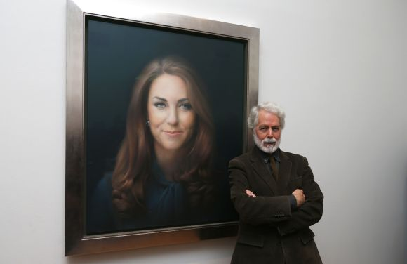 Glasgow-born artist Paul Emsley poses next to hisoil painting of Britain's Catherine, Duchess of Cambridge, the first commisioned portrait of her, at the National Portrait Gallery in central London
