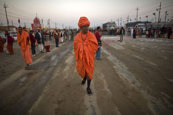A Sadhu walks as he takes part in a religious procession near the banks of Ganga in Allahabad on Monday