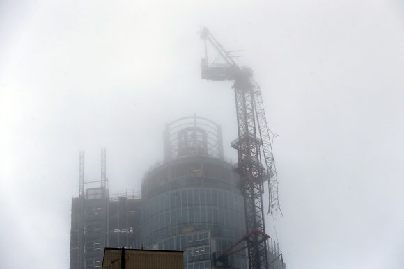 A damaged crane is seen on the St George's Tower in Vauxhall, after it was hit by a helicopter, in London on Wednesday