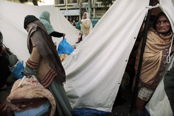 A supporter of Dr Qadri watches from her tent during their third day of protest in Islamabad on Wednesday