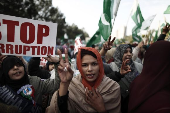 A supporter of Dr Qadri gestures as she takes part in a protest in Islamabad