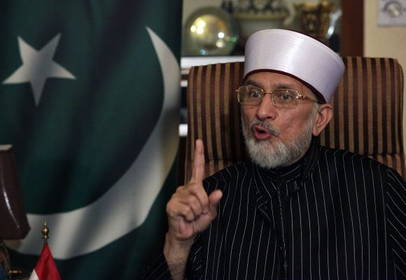 Dr Qadri speaks during an interview in Lahore