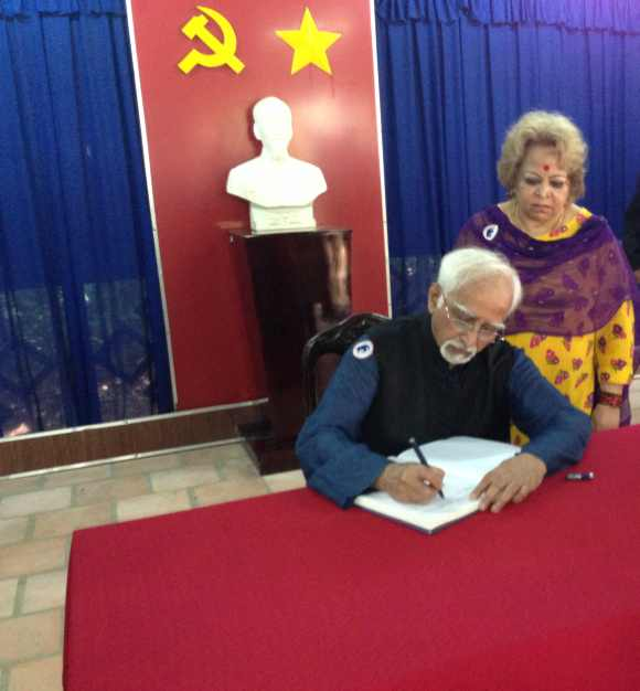 Ansari signs the visitors book at Cu Chi camp