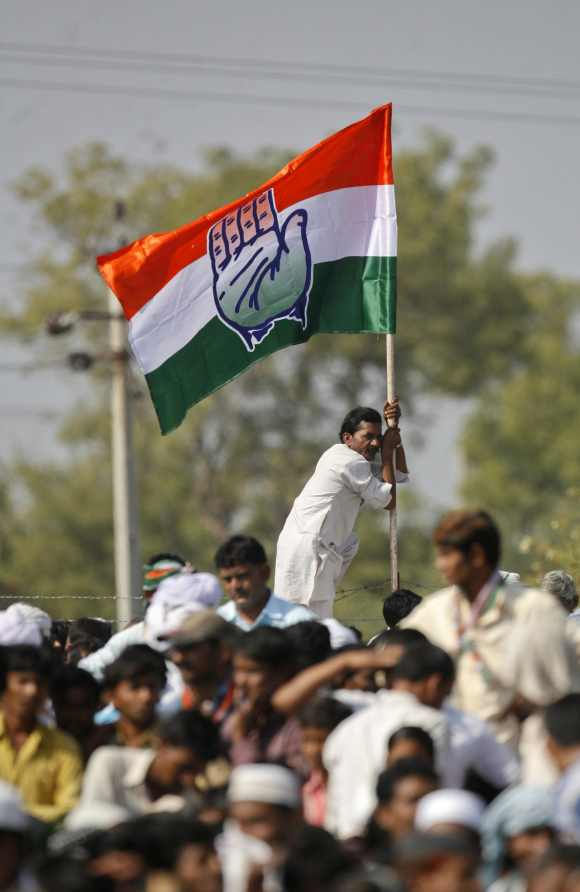 A supporter of the Congress Party holds onto a party flag