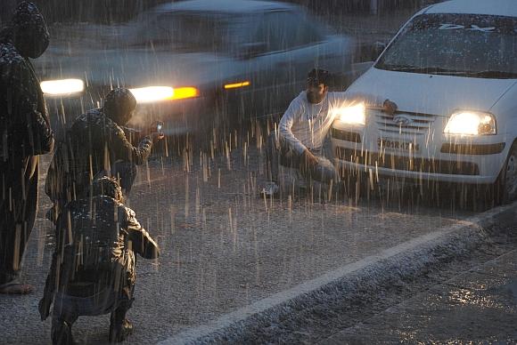 Youths enjoying during the snowfall in Srinagar