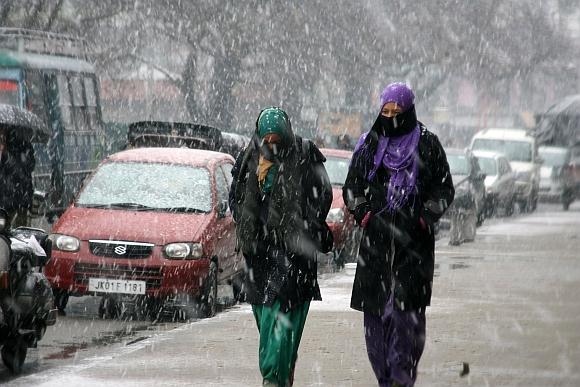Kashmiri girls enjoying the snowfall