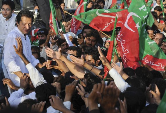 Imran Khan surrounded with supporters as he leads peace march against US drone strikes in Mianwali in October, 2012
