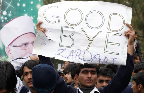 A supporter of Dr Tahir-ul Qadri holds up a sign during the fourth day of protest in Islamabad