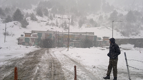A security personnel stands guard at Jawahar Tunnel