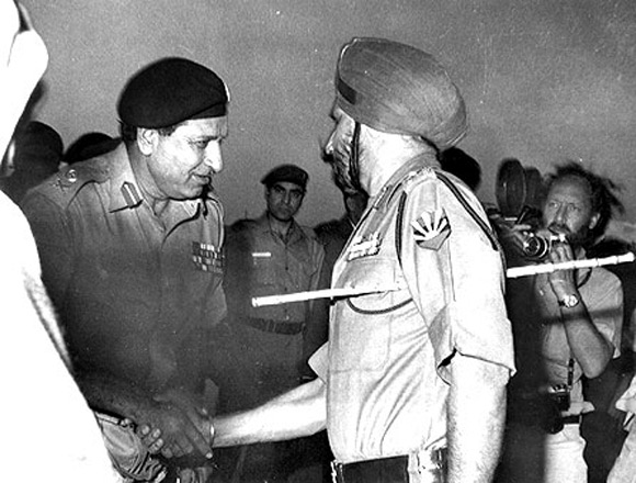 The image that haunts the Pakistan army: Pakistan Lieutenant General A A K Niazi, left, with Lieutenant General Jagjit Singh Aurora, General Officer Commanding-in-Chief, Eastern Command, after Pakistani forces surrendered in Dhaka, December 16, 1971.