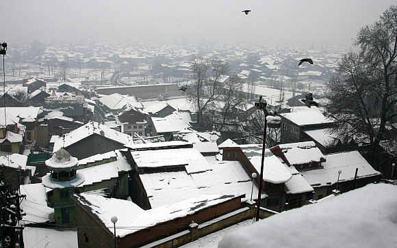 A view of the snow covered Srinagar city after the heavy snowfall