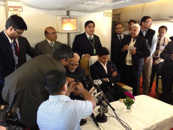 Vice President Hamid Ansari gets ready for his onboard press conference