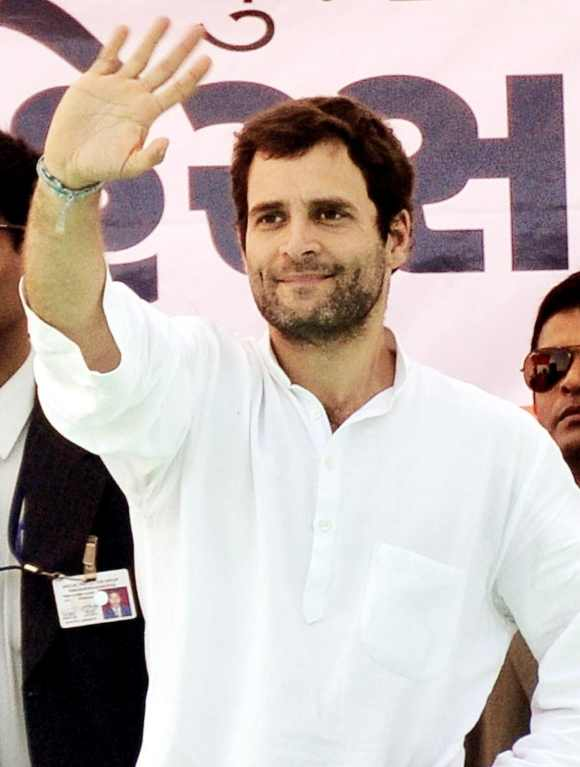 Rahul waves to his supporters during a rally