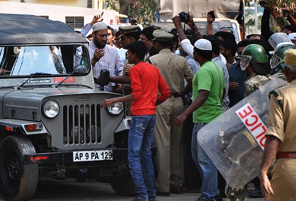 Asaduddin being led by a police escort