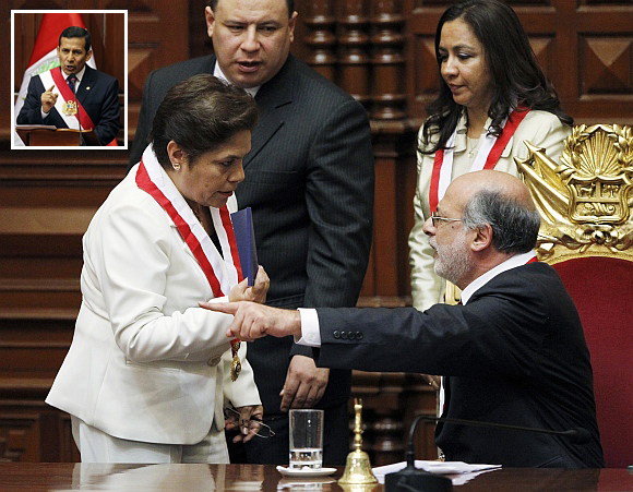 Peruvian congresswoman Luz Salgado (left) holds a copy of the current Constitution while arguing with Congress President Daniel Abugattas after the swearing in of (inset) Ollanta Humala as Peru's new president, in Lima