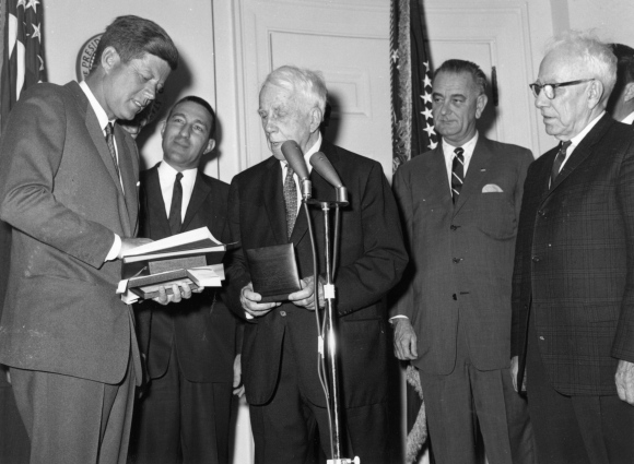 Robert Frost is presented with a medal by President John F Kennedy at the White House