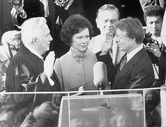 Jimmy Carter is sworn in by chief justice Earl Burger as the 39th president of the United States while first lady Rosalynn looks on, Washington DC