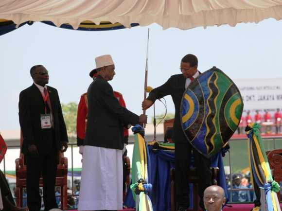 President of Tanzania Jakaya Kikwete receives a spear and shield during his swearing in