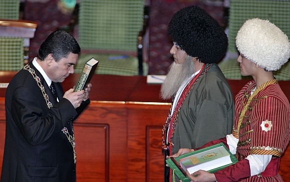 Turkmenistan's new leader Kurbanguly Berdymukhamedov swears an oath during his inauguration as president in Ashgabad February 14, 2007