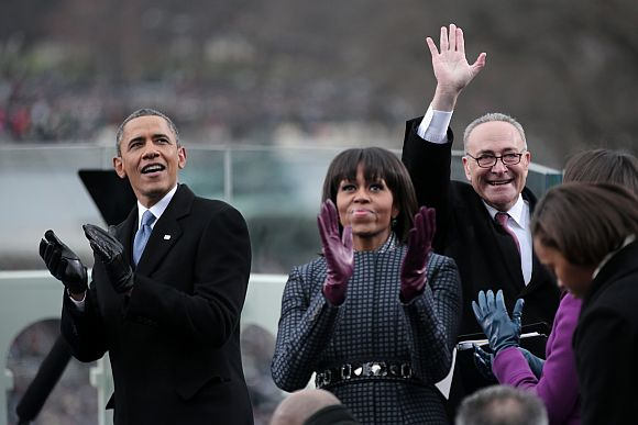 US President Barack Obama, First lady Michelle Obama and US Sen Charles Schumer (D-NY) clap