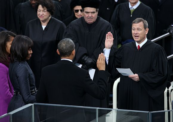 Barack Obama is sworn in by Supreme Court Chief Justice John Roberts