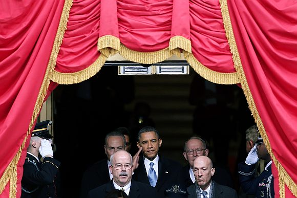 US President Barack Obama salutes as he arrives during the presidential inauguration