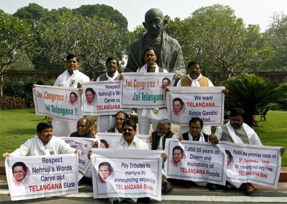 Political leaders hold posters demanding a seperate state of Telangana