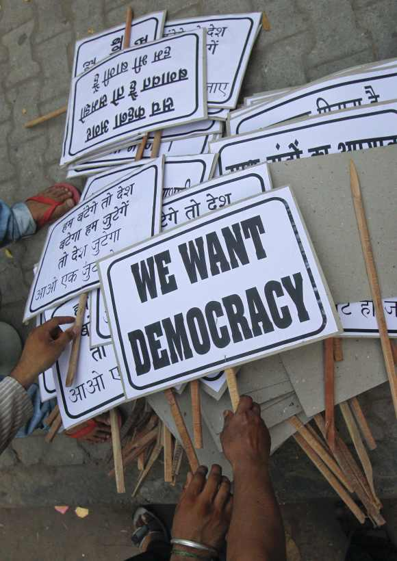Protestors before an anti-government demonstration in New Delhi.