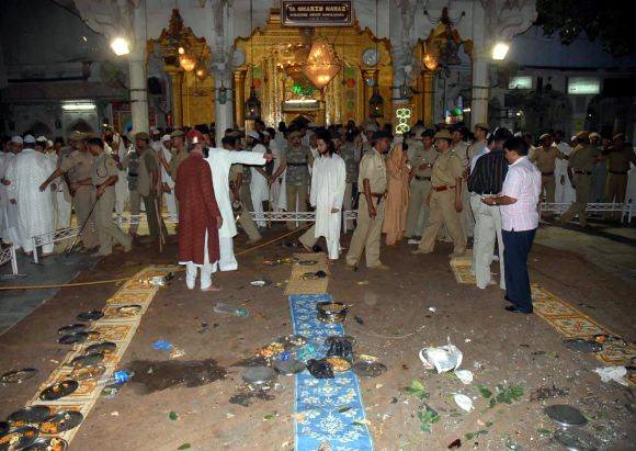 Security personnel and onlookers stand at the site of a bomb blast at the shrine of Sufi saint Khwaja Moinuddin Chisty in Ajmer in 2007