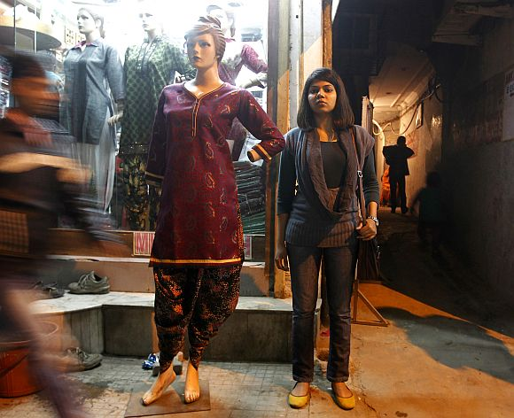 Richa poses next to a mannequin at a market in New Delhi
