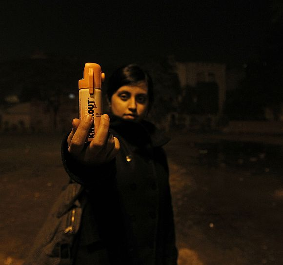 Shaswati Roy Chaoudhary, 23, who works for an online fashion company holds a bottle of pepper spray in a public park in New Delhi