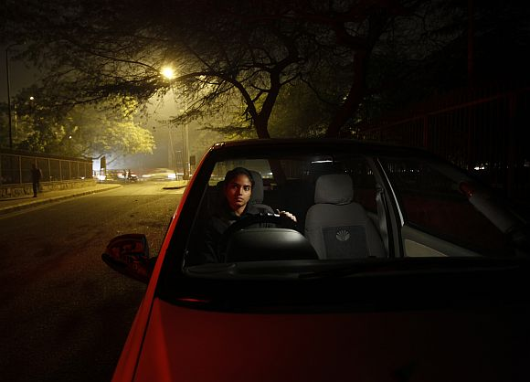 Chandani inside her car on a street in New Delhi